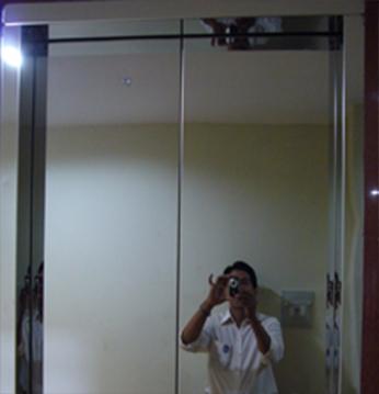Khung bản hẹp : Inox Gương - Cánh cửa tầng : Inox Gương